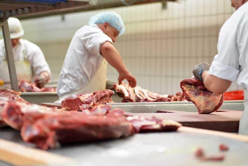 butcher cuts meat