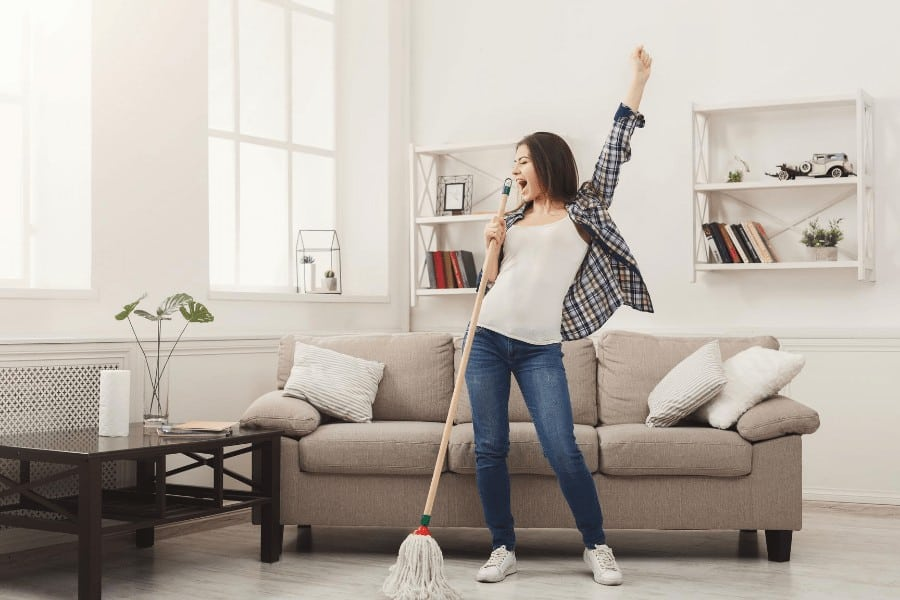 woman celebrating a clean home
